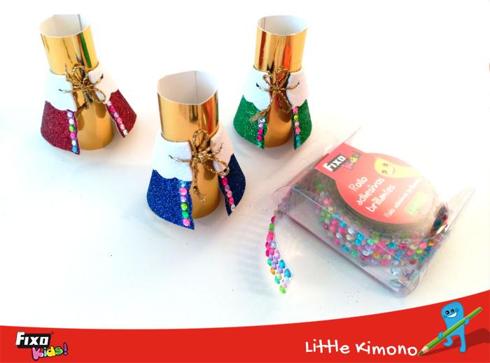 decorar cartulinas con cintas adhesivas brillantes