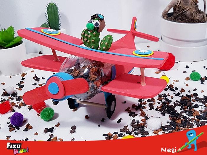 manualidad día del medio ambiente avion macetero